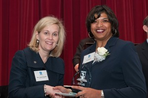 Dr. Zina McGee receives her award at the SCHEV Outstanding Faculty Award Luncheon.