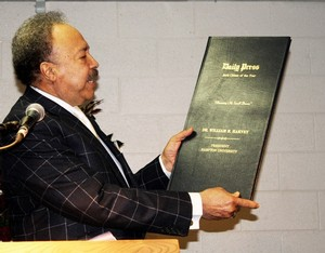 President William R. Harvey receives a gift from the Hampton University Academic Leadership Team in celebration of being named the Daily Press Citizen of the Year for 2010. The gift was presented to the president at the March 2011 Faculty Meeting and is a collection of Daily Press articles regarding Dr. Harvey and the Hampton University Proton Therapy Institute. Dr. Harvey was named Citizen of the Year in recognition of more than three decades of contributions to the local, state and national communities culminating with the opening of the Hampton University Proton Therapy Institute in 2010.
