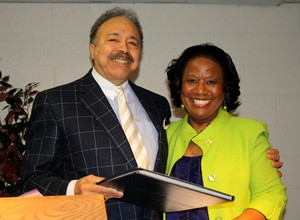 President William R. Harvey shown here with Dr. Pamela V. Hammond, Provost, receives a gift from the Hampton University Academic Leadership Team in celebration of being named the Daily Press Citizen of the Year for 2010. The gift was presented to the president at the March 2011 Faculty Meeting and is a collection of Daily Press articles regarding Dr. Harvey and the Hampton University Proton Therapy Institute. Dr. Harvey was named Citizen of the Year in recognition of more than three decades of contributions to the local, state and national communities culminating with the opening of the Hampton University Proton Therapy Institute in 2010.
