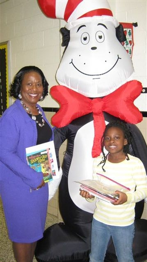 Dr. Pamela Hammond, Hampton University Provost, enjoys meeting The Cat In The Hat with a Lee Hall Elementary Third Grade Student after reading to Mrs. Buchinsky's and Ms. Carrithers' First Grade Classes for 'Read Across America Day.'
