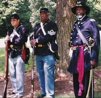 L-R: David Smith and Ross Fowler, 102nd USCT, Detroit, Michigan and Khabir Shareef, Indianapolis, Indiana, portraying Major Martin Delaney, 104th USCT