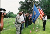 Sgt. Major Charles Scott, Mississippi Sixth District American Legion Commander leads ritual of laying flower wreath at grave of Civil War soldiers