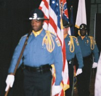 Vicksburg ROTC color guards march into auditorium with flags for color-guard ceremony at Vicksburg City Auditorium.