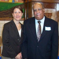 Kimberly Gilmore, Ph.D, Historian and Director, and Korean War Veteran Bennie McRae