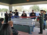 Removing and folding the flag - pallbearers were family members and Bexar County Buffalo Soldiers. Background right photo Mr Puente of Puente and Sons Funeral Chapels, San Antonio, Texas.