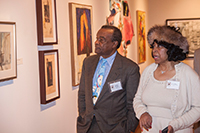 Dr. David Driskell and Dr. Dianne Whitfield Locke walk through the exhibition, Building on Tradition