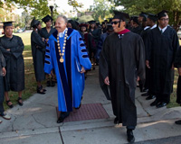 Dr. William R. Harvey and Brett Pulley lead the processional to the HU Opening Convocation in Ogden Hall.