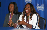 Francena McCorory and Kellie Wells answer questions at the meet and greet event.