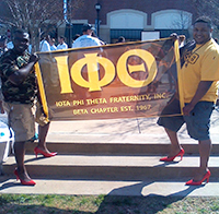 Members of Iota Phi Theta Fraternity Edward Robinson and Dr. Eric Marshall II at the 'Walk A Mile in Her Shoes' event.