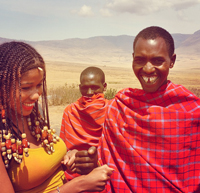 A member of the Maasai tribe poses with Thomas and shares a smile.
