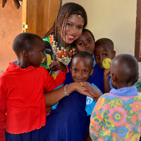 Thomas shares not only knowledge but hugs with the children in Tanzania