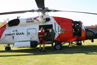 Coast Guard helicopter lands on campus to bring awareness about the opportunities and scholarships available for students.