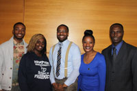 Dr. David Ombengi (on right) with students.