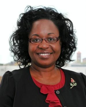 Dr. Michelle Claville