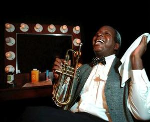 Playwright and Performer Danny Mullen portrays legendary Louis Armstrong