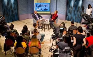 (From left) SHSJC Associate Professor Wayne Dawkins interviews Paula Williams Madison before an audience of students, staff and faculty at the April addition of Caldwell Cafe.