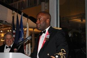 (From right) LTC Good praises SFC(R) Bullard for his steadfast support of the Pirate Battalion.