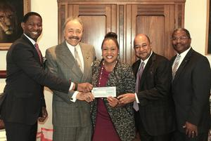 Verizon executives present the check to HU President Dr. William R. Harvey. (L to R) Kwame Trotman, Vice President Customer Service; Dr. Harvey; Karen Campbell, Vice-President State Government Affairs; Tony Lewis, Verizon's Mid-Atlantic Region Vice President and Arthur G. Affleck, Associate Vice President for Development & Director of the Campaign for HU.