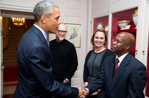From Left: President Barack Obama shakes hands with Dr. Paul Gueye of Hampton University in the White House China Room.