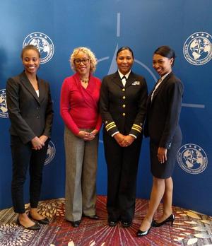 Sydney Merrell, Prof. Carol Davis, US Navy Lieutenant Commander Karen E. Eifert and Atiya Strange (left to right)
