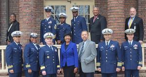 Hampton University administrators pose with Coast Guard officers.