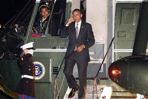 Maj. Justin Howe sits in cockpit as President Obama exits Marine One