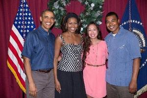 Maj. Howe and his wife pose with President Obama and Michelle Obama