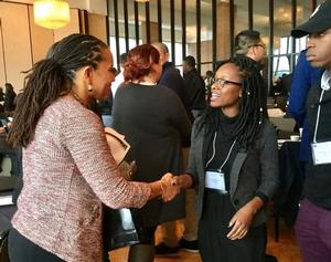 Hampton University Leadership Institute Fellow Kenyatta Wheeler '17 speaks to Ms. Sheena Wright, President/CEO of the United Way NYC during the NCEA at the U.S. Military Academy at West Point, NY.