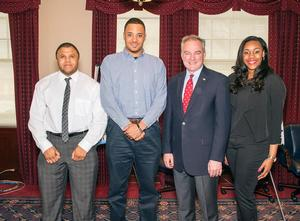 HU cyber security and information assurance students pictured with Sen. Kaine. (Marcellus Williams, Charles Jones and Courtney Hayslett left to right)