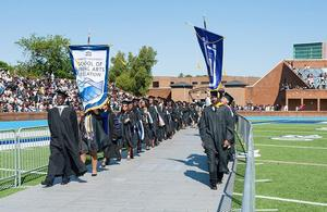 The Class of 2017 march into Armstrong stadium