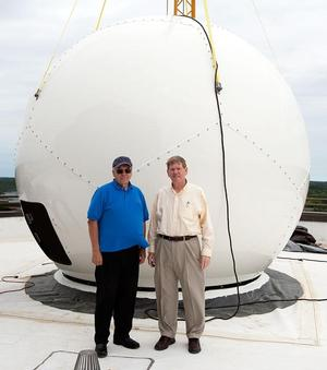 Drs. Pat McCormick & James M. Russell III with the Hampton University Direct Broadcast Weather Antenna installed on top of the Harbour Centre.