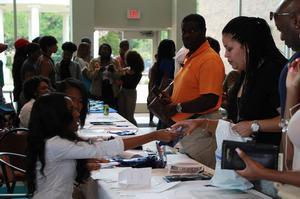 Parents register for Parents' Weekend inside of Hampton University's Student Center