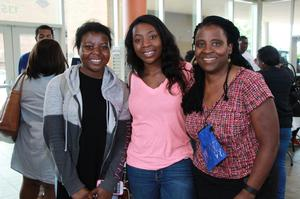 Angel Okrah poses with her daughters, freshmen Susan and Anne Okrah.