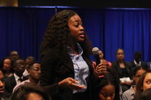 HU student asking panel a question during open forum