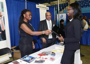Recruiters interacting with Hampton University students