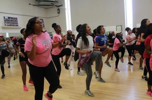 Students, staff and alumni take part in fitness dancing to support breast cancer awareness