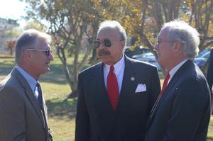 Dr. William R. Harvey, University President speaks with VA Secretary Layne (left) and attorney Waldo (right)