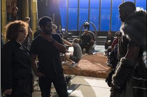 Carter (left) on set with Black Panther Director Ryan Coogler (middle) and actor Winston Duke (right) discuss the costume of M'Baku. (Marvel)