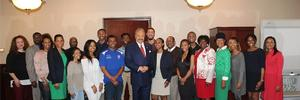 Hampton University President Dr. William R. Harvey and HU Student Government Association President Martha Baye pose with administrators and other student leaders after a successful meeting Thursday, Feb. 22, 2018.