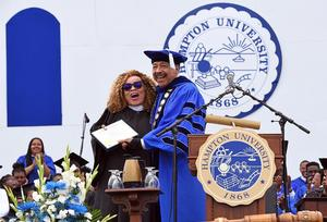 Dr. William R. Harvey shares speacial moment with keynote speaker Ruth E. Carter. Dr. Harvey presents Carter with her diploma from 1982, Carter missed her own graduation ceremony.