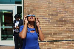 Dr. Barbara Inman, Hampton University's Vice President of Student Affairs, watches the Great American Eclipse from campus.