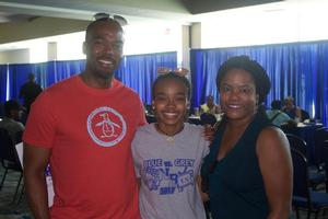 Mom and Dad excited to help their daughter jump start Pre-College.