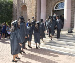 The Class of 2018 march into Ogden Hall.