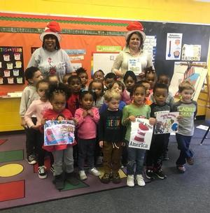 Director Joy Phelps takes a photo with children at the Child Development Center
