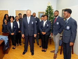 Dr. Harvey poses with his new WRHLI blazer and the W.D.C. Harvey Scholars
