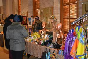Shoppers at the Holiday and Kwanzaa Marketplace