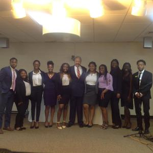 HU President Dr. William R. Harvey takes a photo with ten of the Leadership Summit Future Leaders who received early admission.
