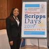 Scripps students pose in front of a Scripps Days poster