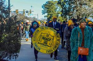 Student organizations marching in honor of Rev. Dr. Martin Luther King Jr.