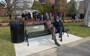 Hampton student sitting with Barack Obama